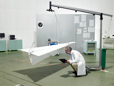 Scientist with Paper Airplane in the lab